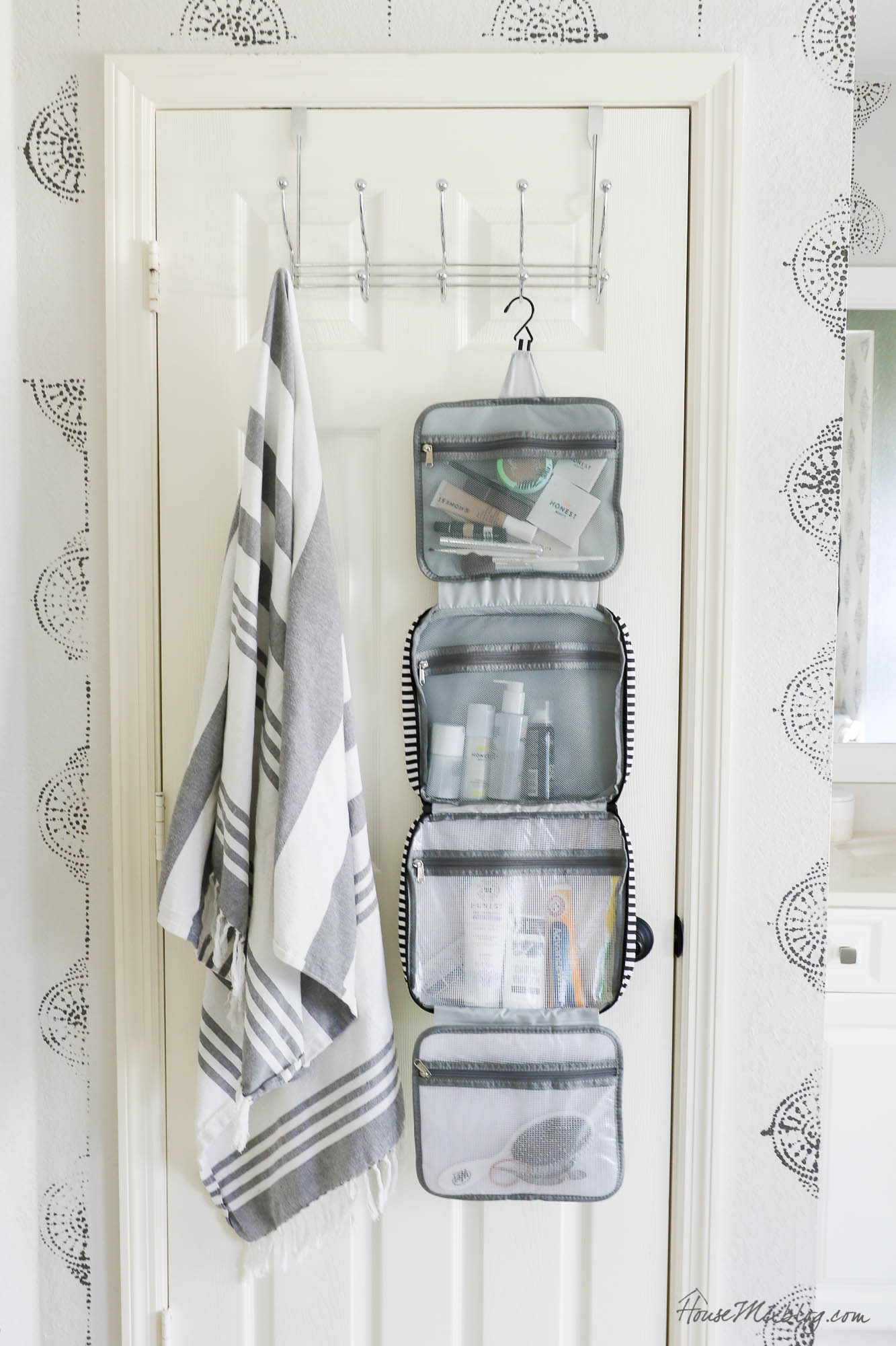 Travel hacks and packing ideas + 2 printable pack lists for women and kids- folding and hanging toiletry makeup bag