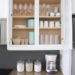 Organized kid cabinet with neutral colors